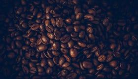 Τα ψημένα φασόλια καφέ, μπορούν να χρησιμοποιηθούν ως ανασκόπηση Στοκ Εικόνα