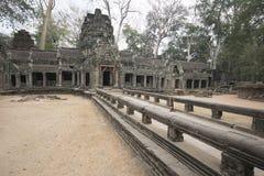 Τα Watt Angkor - τοίχοι καταστροφών ναών TA Prohm της khmer πόλης Angkor wat εγκαταστήστε στην Καμπότζη - δηλώνουν το μνημείο Στοκ φωτογραφία με δικαίωμα ελεύθερης χρήσης