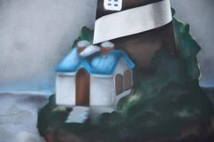 Τεμάχιο ενός παλαιού τοίχου με τη ζωηρόχρωμη ζωγραφική γκράφιτι στοκ φωτογραφία
