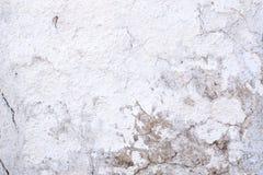 Τεμάχιο κινηματογραφήσεων σε πρώτο πλάνο του άσπρου shabby τοίχου πετρών Στοκ Εικόνες