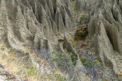 Τεμάχιο μιας βουνοπλαγιάς με τα ίχνη αυστηρής εδαφολογικής διάβρωσης Στοκ εικόνες με δικαίωμα ελεύθερης χρήσης