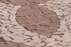 Τεμάχιο της αστικής σύστασης πεζοδρομίων πετρών κεραμιδιών στοκ φωτογραφία