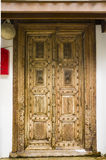 Τεμάχιο της ξύλινης γλυπτικής στην πόρτα Στοκ Φωτογραφίες