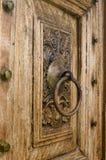 Τεμάχιο της ξύλινης γλυπτικής στην πόρτα Στοκ φωτογραφία με δικαίωμα ελεύθερης χρήσης