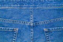 Τεμάχιο του μπλε τζιν ιματισμού με τις τσέπες Στοκ Εικόνα
