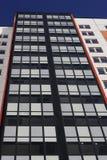 Τεμάχιο του multi-storey κοιτάγματος σπιτιών στον ουρανό Στοκ Εικόνα