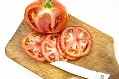 τεμαχίστε την ντομάτα Στοκ εικόνες με δικαίωμα ελεύθερης χρήσης