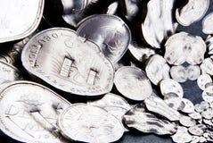 Τεμαχισμένα νομίσματα σημαδιών Στοκ Φωτογραφίες