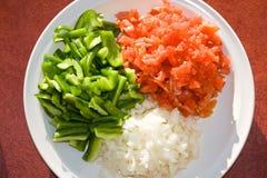 Τεμαχισμένα ντομάτες, πιπέρι και κρεμμύδια Στοκ φωτογραφία με δικαίωμα ελεύθερης χρήσης
