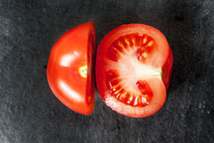 Τεμαχισμένη ντομάτα, τρία κομμάτια Στοκ εικόνα με δικαίωμα ελεύθερης χρήσης