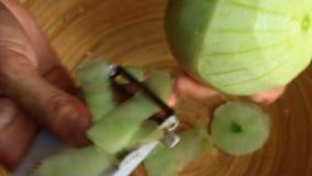 Τεμαχισμός μιας φέτας πεπονιών φιλμ μικρού μήκους