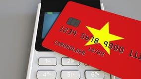 Τερματικό πληρωμής με την πιστωτική κάρτα που χαρακτηρίζει τη σημαία του Βιετνάμ Βιετναμέζικη εθνική εννοιολογική τρισδιάστατη ζω φιλμ μικρού μήκους