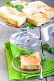 Τετράγωνα cheesecake στοκ φωτογραφία