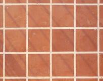 Τετραγωνική σύσταση υποβάθρου κεραμιδιών πατωμάτων τερακότας Στοκ Φωτογραφία
