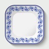 Τετραγωνικό πιάτο πορσελάνης με ένα μπλε σχέδιο στο ύφος της εθνικής πορσελάνης που χρωματίζει Gzhel ελεύθερη απεικόνιση δικαιώματος