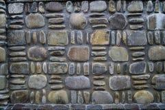 τεχνητός μπλε ελαφρύς τοίχος πετρών σύσταση των στρογγυλών χρωματισμένων πετρών Στοκ Εικόνα