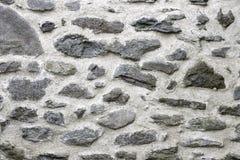 τεχνητός μπλε ελαφρύς τοίχος πετρών μεγάλες πέτρες Στοκ Φωτογραφία