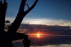 Τελείωμα της ημέρας με ένα ηλιοβασίλεμα Στοκ Εικόνες