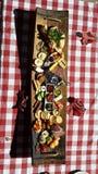 Τελευταία χώρα cheeseboard gingham στο ύφασμα Στοκ Φωτογραφία