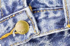 Τζιν παντελόνι με τα στηρίγματα ορείχαλκου Στοκ εικόνα με δικαίωμα ελεύθερης χρήσης