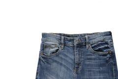 Τζιν παντελόνι στην άσπρη ανασκόπηση Στοκ Φωτογραφίες