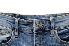 Τζιν παντελόνι στην άσπρη ανασκόπηση Στοκ Εικόνες