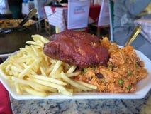 Τηγανητά, ρύζι και κοτόπουλο Στοκ Εικόνες