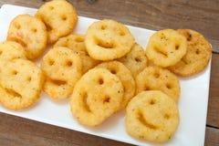 Τηγανισμένα πατάτα smileys τσιπ Στοκ φωτογραφία με δικαίωμα ελεύθερης χρήσης