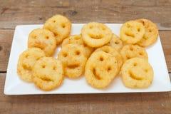 Τηγανισμένα πατάτα smileys τσιπ Στοκ Φωτογραφία