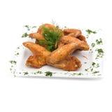 Τηγανισμένα φτερά κοτόπουλου στο λευκό Στοκ Εικόνα