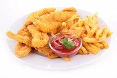 Τηγανισμένες κοτόπουλο και τηγανιτές πατάτες στοκ εικόνες
