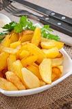 τηγανισμένες σφήνες πατατών Στοκ Εικόνες