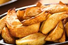 τηγανισμένες σφήνες πατατών Στοκ Φωτογραφία
