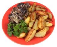 Τηγανισμένοι πατάτα, μανιτάρια και μαϊντανός. Στοκ Φωτογραφίες