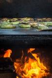 Τηγανισμένο κολοκύθι με το μαγείρεμα της πυρκαγιάς Στοκ εικόνα με δικαίωμα ελεύθερης χρήσης