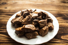 Τηγανισμένο κρέας σε ένα πιάτο Στοκ Εικόνες