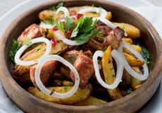 Τηγανισμένο κρέας στις πατάτες Στοκ Εικόνα
