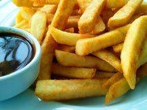 Τηγανιτές πατάτες στο πιάτο Στοκ Εικόνες