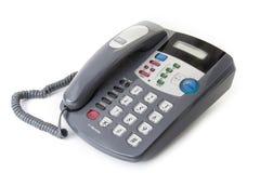 Τηλέφωνο γραφείων γραφείων με το κουλουριασμένο τηλεφωνικό σκοινί Στοκ Φωτογραφίες