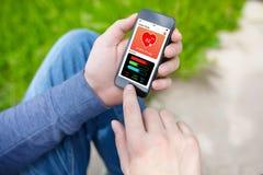Τηλέφωνο εκμετάλλευσης ατόμων με app το stree οθόνης δραστηριότητας καταδίωξης υγείας Στοκ φωτογραφία με δικαίωμα ελεύθερης χρήσης