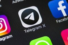 Τηλεγράφημα Χ εικονίδιο εφαρμογής στο iPhone Χ της Apple κινηματογράφηση σε πρώτο πλάνο οθόνης Τηλεγράφημα Χ app εικονίδιο Το τηλ Στοκ εικόνα με δικαίωμα ελεύθερης χρήσης