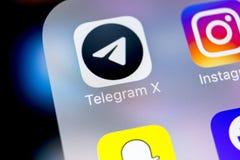 Τηλεγράφημα Χ εικονίδιο εφαρμογής στο iPhone Χ της Apple κινηματογράφηση σε πρώτο πλάνο οθόνης Τηλεγράφημα Χ app εικονίδιο Το τηλ Στοκ Φωτογραφία