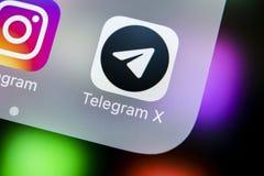 Τηλεγράφημα Χ εικονίδιο εφαρμογής στο iPhone Χ της Apple κινηματογράφηση σε πρώτο πλάνο οθόνης Τηλεγράφημα Χ app εικονίδιο Το τηλ Στοκ φωτογραφία με δικαίωμα ελεύθερης χρήσης