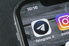 Τηλεγράφημα Χ εικονίδιο εφαρμογής στο iPhone Χ της Apple κινηματογράφηση σε πρώτο πλάνο οθόνης Τηλεγράφημα Χ app εικονίδιο Το τηλ Στοκ εικόνες με δικαίωμα ελεύθερης χρήσης