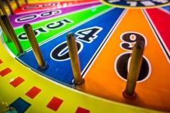 Τηλεοπτικά παιχνίδια Arcade και φω'τα και περιστρεφόμενες ρόδες Στοκ Φωτογραφίες