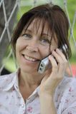 τηλεφωνική ομιλούσα γυν Στοκ Εικόνες