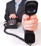 τηλεφωνικός δέκτης εκμετάλλευσης επιχειρηματιών στοκ φωτογραφία με δικαίωμα ελεύθερης χρήσης