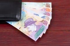 Της Βενεζουέλας Bolivares στο μαύρο πορτοφόλι στοκ φωτογραφίες