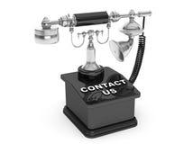 τηλέφωνο αναδρομικό Εκλεκτής ποιότητας τηλέφωνο με την επαφή εμείς σημάδι Στοκ Φωτογραφία