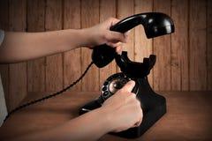 Τηλέφωνο εκμετάλλευσης χεριών και αριθμός σχηματισμού Στοκ Εικόνα